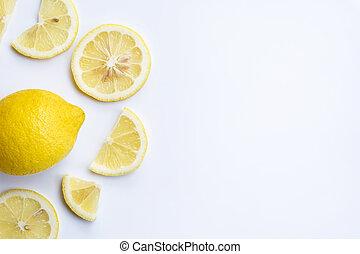 Fresh lemon slices on white background.