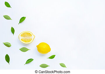 Fresh lemon with leaves on a white background.