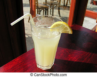 fresh lemonade - on a sunny day in city cafe