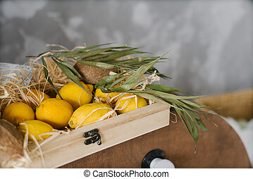 Fresh lemons are in a wooden box