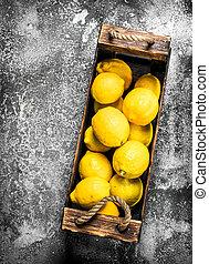 Fresh lemons in a wooden box.