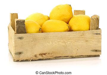 fresh lemons in a wooden box