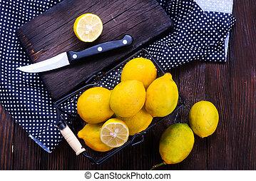lemons - fresh lemons in basket and on a table