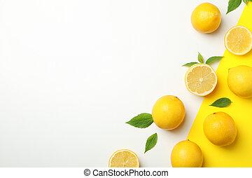 Fresh lemons on two tone background, top view. Ripe fruit