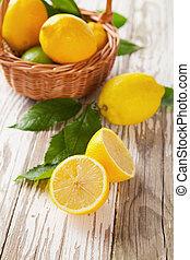 Fresh lemons - Fresh harvested lemons in basket