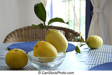 Fresh lemons with leaves on the table