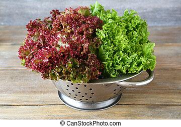 Fresh lettuce in a colander