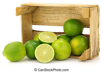 fresh lime fruit in a wooden crate