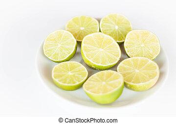 Fresh lime slice on white ceramic dish