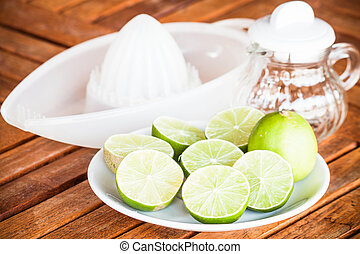 Fresh lime with glass jar and hand squash tool