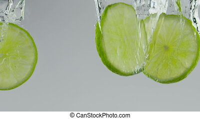 fresh limes - limes dropping water