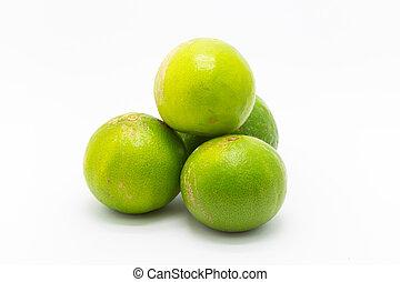 Fresh limes fruit on white