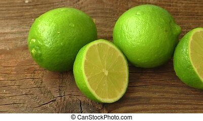 Fresh limes on wooden background