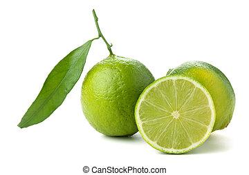 Fresh limes with green leaf