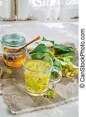 Fresh linden tea with honey for flu