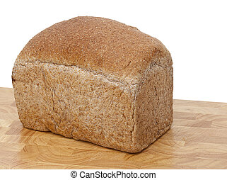 Fresh loaf brown wholemeal bread - A fresh loaf of brown ...