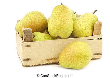 fresh Lucas pears in a wooden crate