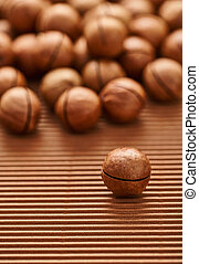 fresh macadam nut close-up on a brown background
