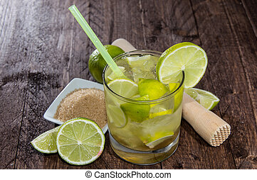 Fresh made Caipirinha on wooden background