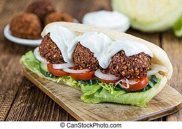 Fresh made Falafel Sandwich (close-up shot) - Fresh made...