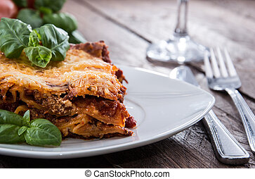 Fresh made Lasagna on a plate decorated with basil