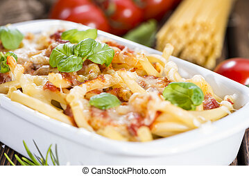 Fresh made Pasta Bake on an old wooden table (close-up shot)