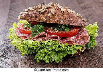 Fresh made Salami Sandwich on wood