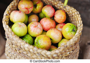 Fresh Malpighiaceae fruit or cherry in burlap sack