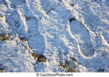 shoe boots footprints in the snow