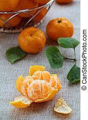 Fresh mandarin orange in a basket on the table