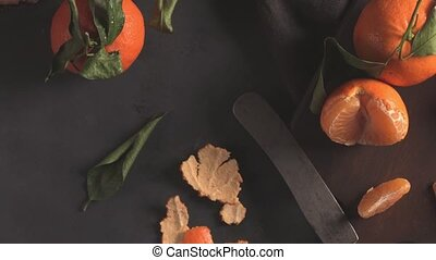 Fresh mandarin oranges or tangerines with leaves on textured...