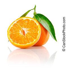fresh mandarine fruit with cut and green leaves