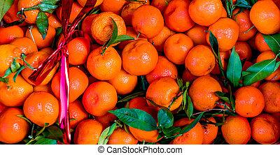Fresh Mandarines or citrus oranges in a box on a farm organc market. Harvest concept. Top view