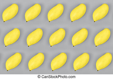 Fresh mango on gray background. Colors of the year 2021: ultimate gray and illuminating. Trendy colors concept, mockup with copy space
