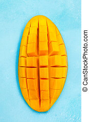Fresh mango organic fruit on blue background. Top view. Close up.