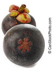 Fresh Mangosteen fruit on white