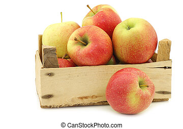 fresh Maribelle apples in a wooden crate