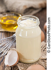 Fresh Mayonnaise (homemade) on an old wooden table