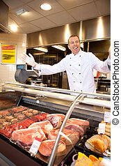 Fresh meat with cheerful butcher - Fresh meat counter with...