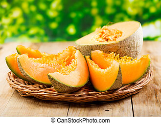 fresh melon on wooden table