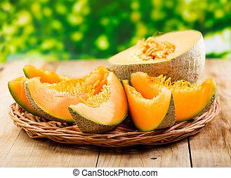 fresh melon on wooden table