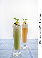 Fresh melon smoothie in a glass on the table