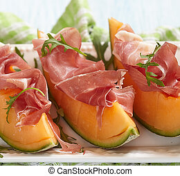 Fresh Cantaloupe Melon with Prosciutto and Arugula