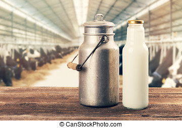 fresh milk bottle and can on the table in cowshed