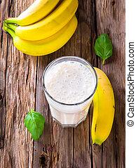 Fresh milk shake on wood