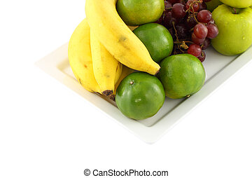 Fresh mixed fruit focus green orange on white background.