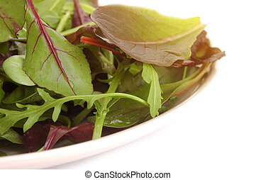 mixed salad - fresh mixed salad leaves over white background