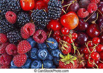 Fresh mixed summer berries - raspberry, strawberry, blueberry