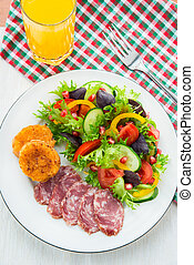 Fresh mixed vegetable salad, sliced sausage and cheese toasts