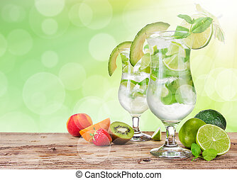 Fresh mojito drinks on wooden table